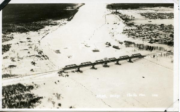 An aerial photograph of the Hudson Bay Railway bridge in The Pas over the Saskatchewan River. Source: Andrew Taylor fonds